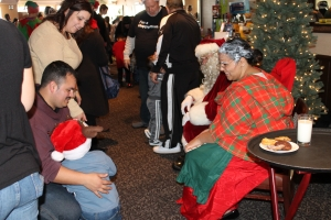 Meeting Santa & Mrs.  Claus:  Sandy Victims get a chance to meet Mr. & Mrs. Claus before picking out toys and coats.