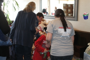 Volunteers brought each family through the piles of donated toys to pick out their perfect holiday gift.