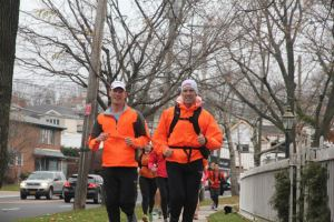 Jamie and Jordan Metzl running their route through Staten Island for their donation deliveries. Photo Credit: Alex Hu