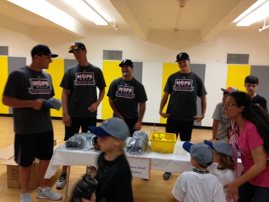 The Staten Island Yankees having fun with some young fans