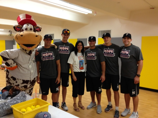 The Staten Island Yankees with happy principal Carol Mongiello of the new P.S. 59 Harbor View School